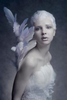 Is this Tinkerbell????  She looks quite worried!.  No  - it's 'The Littliest Angel' just sprouting her wings.  OH!