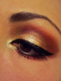 "Gold eye make up...reminds me of the ""sunset"" i used to do on my eyes and makes me want to pull out those colours!!"