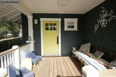 love this color combo for a house. dark grey, white trim, and a yellow door.