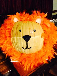 Pumpkin decorated as a lion with 2 orange boas, paint, and felt. Super easy!