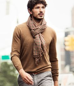 Printed scarf draws attention to the face with a solid colored shirt. A matching cap would complete the look.
