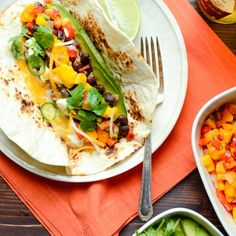 Easy vegetarian tacos have that smoky heat you expect from Mexican fare!  Top with fresh avocado and mango salsa!