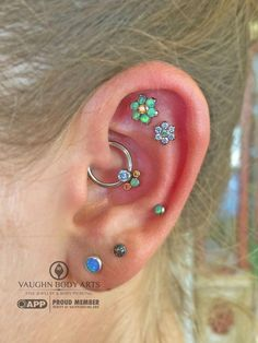 Ashleigh's ear looks amazing with all of these lovely pieces from anatometal. She had us order her some flowers and a cluster for her daith piercing, and what lovely gem combinations she. Gold Bar Earrings, Tiny Stud Earrings, Unique Earrings, Fancy Earrings, Daith Earrings, Daith Piercing, Body Piercings, Unique Ear Piercings, Ear Jewelry