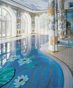 Exquisite glass inserts are incorporated into this shallow water ...