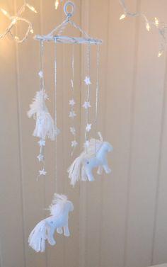 White Felt Horse Baby Mobile/ Nursery Decor by TheHillbillyKid, $65.00 cute :-)