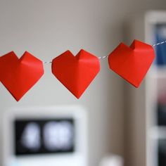 Fold puffy hearts from squares of origami paper and string them to make a Valentine's Day garland.