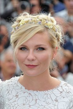 Kirsten Dunst rocks girlie braids with a floral headband at #Cannes!