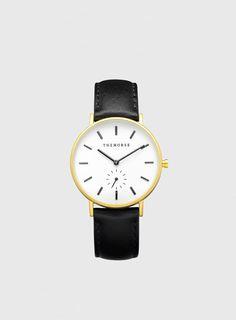 Schlichte goldene Uhr mit Lederband von The Horse