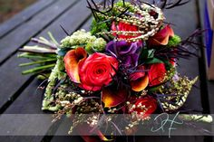purple and orange wedding bouquet. calla lilies, kale, roses. etc.  Wedding flowers by Sophisticated Floral Designs. Portland, OR http://sophisticatedfloral.com/