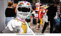 Sheffield, UK - June 12, 2016:  Cosplayer dressed as 'White Wild Force Ranger' from the American TV series 'Wild Force Power Rangers' at the Yorkshire Cosplay Convention at Sheffield Arena
