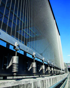 Architectural Wire Mesh can be tensioned covering several floors of a building. For bottom mountings the use of flat tension profiles is recommended.