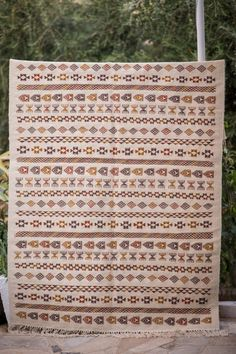This is a Tunisian Vintage Style Handwoven Margoum Kilim Rug, made with natural wool in berber style. Showcasing Berber multicolore patterns on a Beige Background and a medium raw surface finishing. Beige Background, Berber Rug, Kilim Rugs, Hand Weaving, Pattern, Handmade, Vintage, Style, Carpet