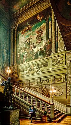 The 18th century painting of a Triumph of the Duchess of Somerset by Louis Laguerre on the Grand Staircase of Petworth House