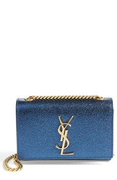 Shop now: Mini Cassandre Crossbody Bag