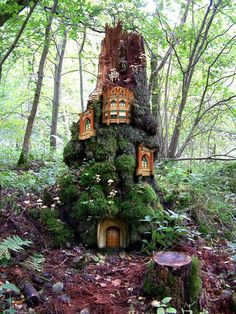 Fairy doors and moss? I wonder if we can pull this off on our lot. I'm sure there will be a dead tree we could use!