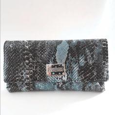 """Faux Snakeskin Wallet/clutch Glossy Faux Snakeskin Wallet/Clutch. It is 9""""W and 5""""L. It can be use as wallet or clutch since it is a bit bigger than a regular wallet. Like new condition. Used only probably 3X. It is grayish &caribbean blue color. It has 2 big slots for cash or receipt & 4 slots for CC & it has a kiss&lock style for coins. Please feel free to ask any questions. Thank you Kenneth Cole Reaction Bags Wallets"""