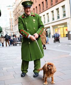 harrods green man door man with cavalier king charles spaniel dog