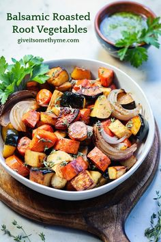 Balsamic Roasted Root Vegetables | giveitsomethyme.com – a delicious medley of caramelized sweet potatoes, acorn squash, carrots, parsnips, and red onion and served with carrot top cashew pesto! #roastedrootvegetables #balsamicroastedrootvegetables #sidedishes #sidedishrecipes #roastedvegetables #glutenfree #vegan #sheetpanrecipes #holidayrecipes #giveitsomethyme