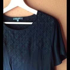 Marty M rayon eyelet tee Really sweet and sharp black eyelet tee from Matty M (Bloomindales and Nordstrom.). Great condition, but please understand that there is really no stretch to this top.  Size medium, very good used condition from my smoke free, pet free home! Matty M Tops