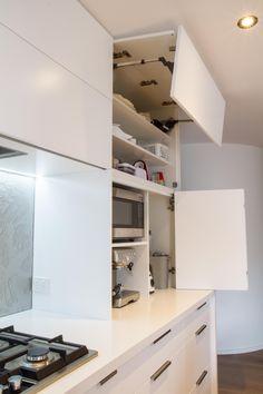 Appliance pantry. Bi-fold doors. White modern kitchen. www.thekitchendesigncentre.com.au