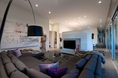 Stylish Residence Interior Design For Your Inspiration: Large Grey Sofa With Purple Cushions Near Black Curved Arch Lamp