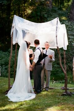 Lace chuppah on birch poles. Photography by youlooknicetodayphotography.com