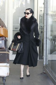 another vote for traveling chic. suicideblonde: Dita Von Teese arriving at Heathrow airport in London today