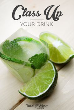 Freeze garnishes in square ice cubes to instantly class up a cocktail. This one is lime and mint to go along with a mojito, but berries also work great. Find your square ice cube trays at TotalWine.com