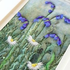 Original textile art by Shropshire-based artist Maxine Smith. A one of a kind needle felted and hand embroidered picture inspired by the natural environment. This piece depicts bluebells and daisies, a typical British woodland or hedgerow scene. I take inspiration from the dramatic