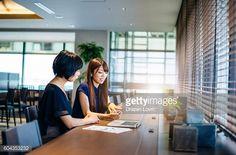 ストックフォト : Two businesswomen on meeting using online data