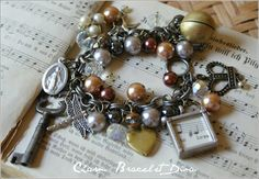 Vintage musical locket and medal charm bracelet