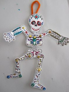 Add a little spooky fun into afternoon crafting with a sweet and simple slinky skeleton. Keep it classic and cool or add color and sparkle for some Dios De Los Muertos delights. time Make a Slinky Skeleton Perfect for Halloween & Día de los Muertos Halloween Crafts For Kids, Paper Crafts For Kids, Diy Halloween Costumes, Halloween Art, Holidays Halloween, Halloween Decorations, Arts And Crafts, Cheap Halloween, Costume Ideas