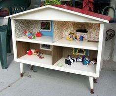 Turn a cabinet or bookcase into a dollhouse.