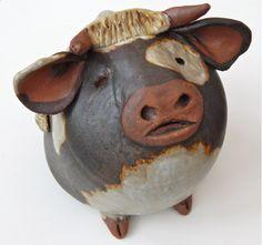 Sandra McKenzie Schmitt pottery.  Fat animal at Good Goods in Saugatuck.  Available at goodgoods.com