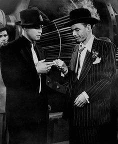 Marlon Brando and Frank Sinatra during a scene of Guys and Dolls , 1955