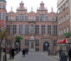 The Great Armoury in Gdańsk/Danzig, Poland with its typical Dutch style (stepped-gable red-brick facade ornamented with light sandstone bands), considered to be the one of the most notable examples of Dutch-Flemish Renaissance architecture in Northern Europe.
