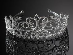 4772. Grand tiara on a a silver band encrusted with diamontes set around a large clear crystal design.