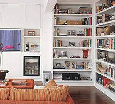 """corner bookshelf idea// new house has odd corner """"nook"""" would be a great space for corner bookshelves to display china/books and for 2 armchairs Corner Bookshelves, Book Shelves, Bookshelf Ideas, Bookcases, Living Room Built Ins, Home Libraries, The Way Home, Apartment Interior Design, White Rooms"""