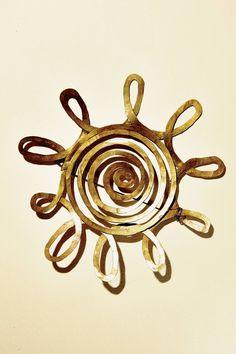 #AlexanderCalder's sun brooch