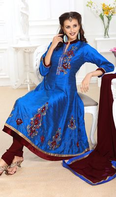 Charming Blue Raw Silk Anarkali Suit Let your beauty flush as you glide in this charming blue raw silk Anarkali suit. The ethnic patch, stones and velvet patch work within the dress adds a sign of elegance statement for your look. #BuyAnarkaliSuitsOnline #AnarkaliSalwarKameez