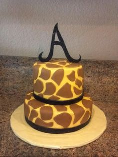 My daughters giraffe cake with her initial