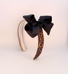 Adorable Infinity Headband with the Cheetah Headband Cover and Black Bow! www.Infinityheadbands.com
