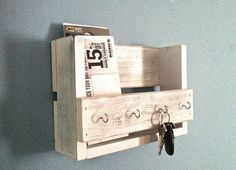 This amazing rustic wooden key holder and mail organizer is made from reclaimed wood (mostly pine) that I have painted and distressed. This will look great in your entryway, mudroom or kitchen. It mea