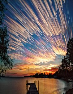 A sunset that looks like a thousand stars are bursting across the sky.