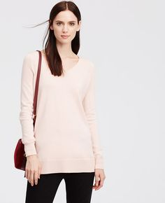 Rendered in a supremely soft merino wool blend, this cozy essential gets modern with a wide V-neck silhouette. V-neck. Long sleeves. Side slits. Ribbed cuffs and hem.