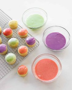 Pastel Cupcake Icings   Martha Stewart Living - Syrups made with fresh blueberries, strawberries, and mint make these pastel icings look as good as they taste. Simply dip white cupcakes in the icings for a stunning display of spring treats.