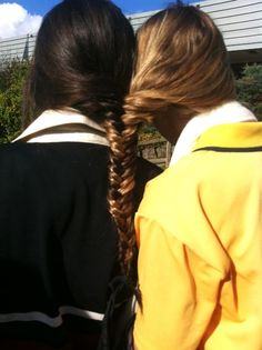 fish tailed together My friend and I did this in High School together, but french-braided... very cool!