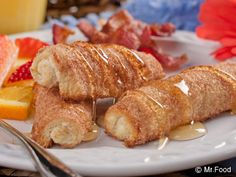 French Toast Rollups - You can eat these portable treats while opening presents under the tree this Christmas morning!