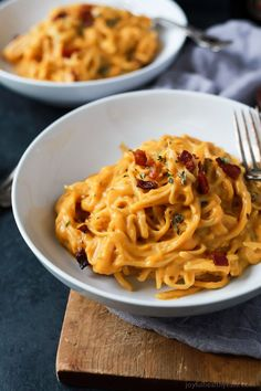 Creamy Butternut Squash Alfredo Pasta permeated with fresh sage and thyme then perfected with a garnish of salty bacon on top! The fall recipe is silky smooth, luscious, healthy and absolutely addicting.