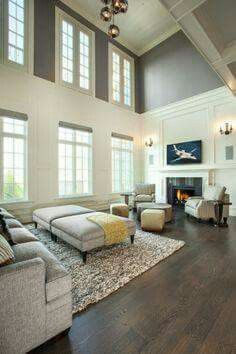Nice idea... simply use molding and paint to divide the massive scale of a 2-story great room.  It instantly adds comfort and creates an inviting atmosphere.